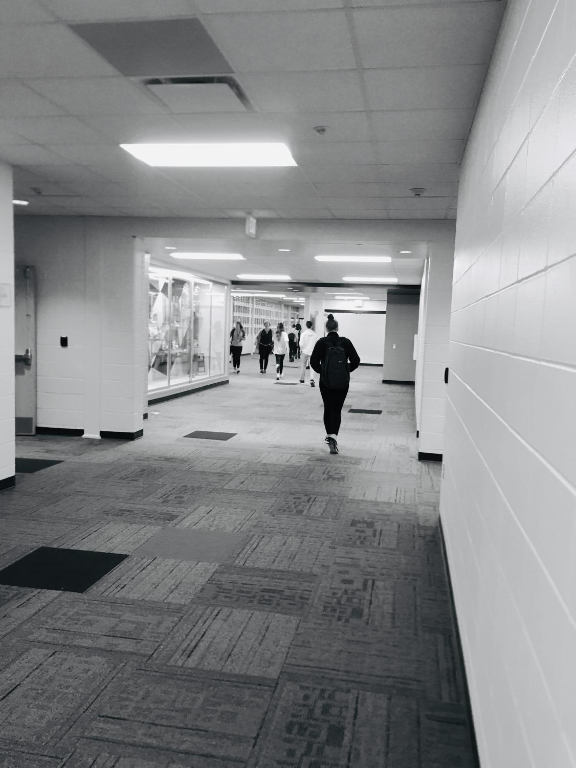 Students and teachers walk between the old building and the new edition which was opened this year.