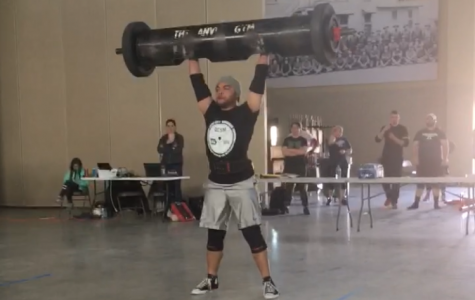 """World's strongest choir teacher"" takes first place in Anvil Strongman competition"