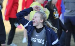 Freshman, Summer Halsey shows her excitement for her fellow teammates' race.