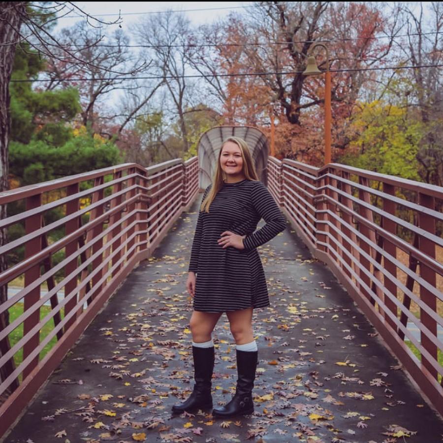 Alexa+Otterson%2C+posing+for+her+senior+graduation+portrait.