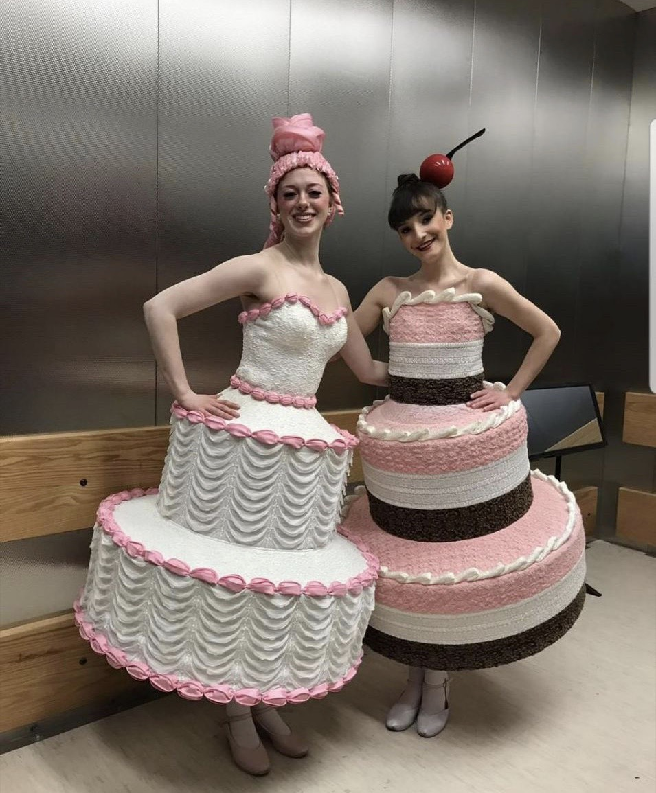 "Haley Zelmer (left) with a fellow cake backstage at ""Whipped Cream""."