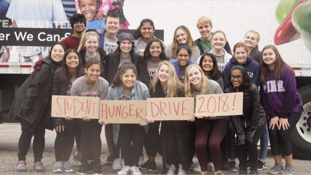 Pleasant Valley students and Spartan Assembly members raise funds and collect food for the student hunger drive.