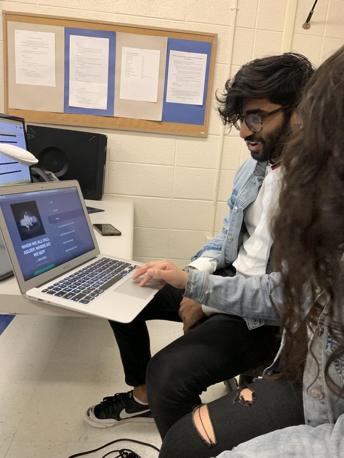 Seniors Angela Pandit and Varun Vedula browse through Billie Eilish's new album.
