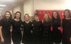 Natalie Murphy, Christine Lyon, Charity Jensen, Emily Johnson, Madison Wells, Rachael Lyon, and Annie Warner stand together after completing their ensemble at the IHMSA Solo and Ensemble Festival.