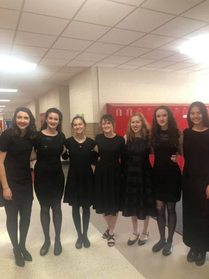 Natalie+Murphy%2C+Christine+Lyon%2C+Charity+Jensen%2C+Emily+Johnson%2C+Madison+Wells%2C+Rachael+Lyon%2C+and+Annie+Warner+stand+together+after+completing+their+ensemble+at+the+IHMSA+Solo+and+Ensemble+Festival.