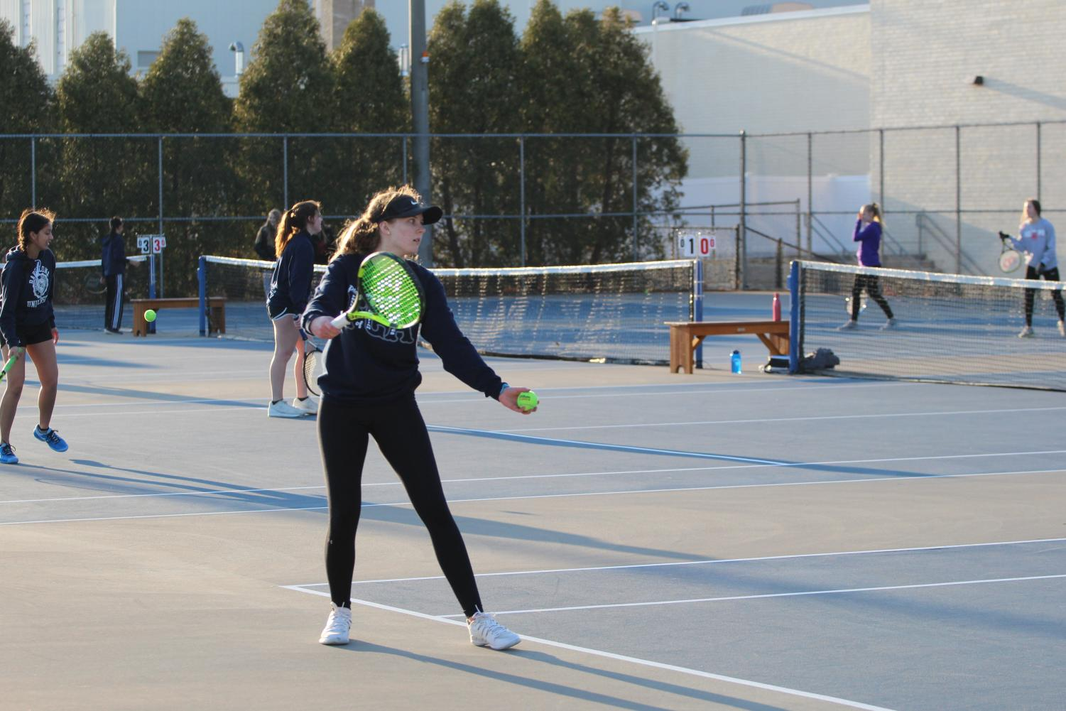 Junior Kayla Nutt preparing to serve against a  North Scott opponent on April 2, 2019.