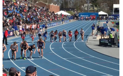 High school athletes line up for the 4x800 meter relay during the 2018 Drake Relays.