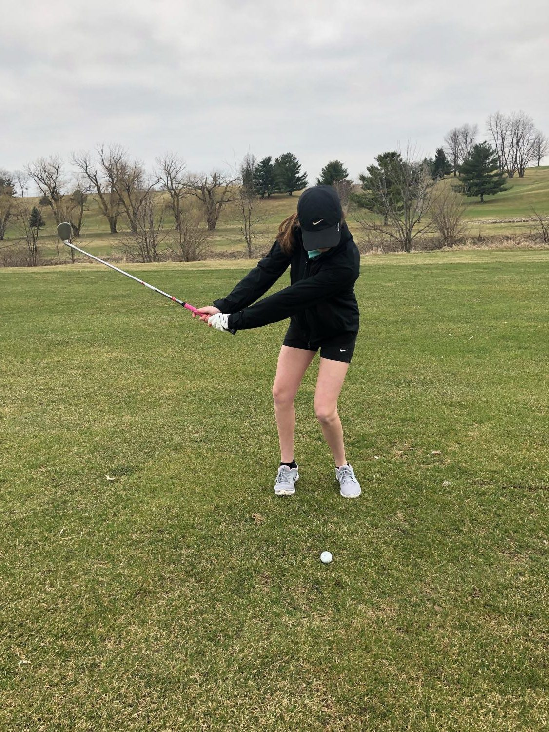 Erika Holmberg, number one player on the PV Girls' Golf team, swings at the ball on Hole 22 at Hidden Hills Golf Course.