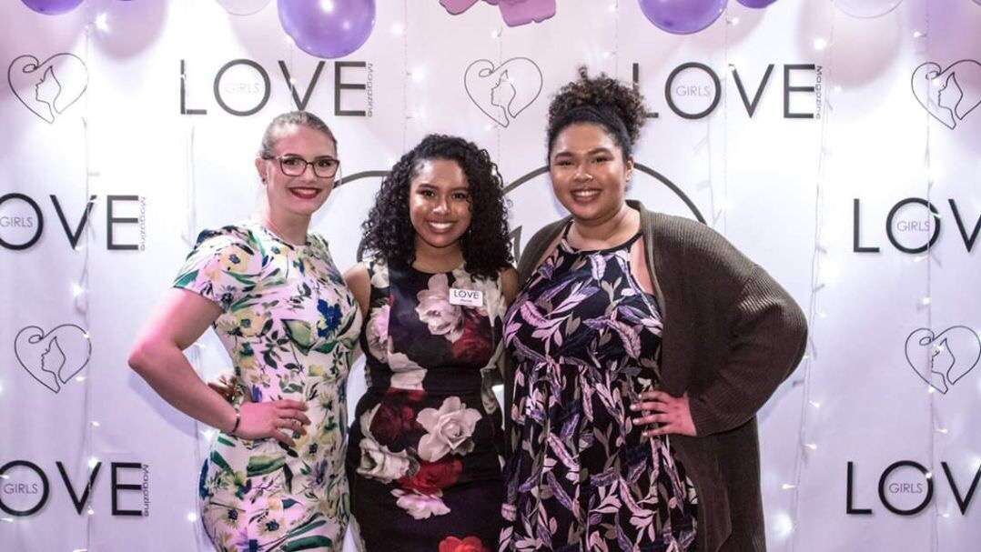 """Senior Mariah Martinez, middle, poses with Hannah Olka, and her sister, PV alumna TaKera Martinez, right, on the Love Award's """"purple carpet."""""""