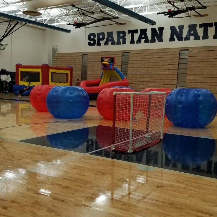 This+picture+shows+some+of+the+activities+available+at+RAP.+Pictured+is+the+human+soccer+ball+inflatables+and+a+slide.%0D%0A