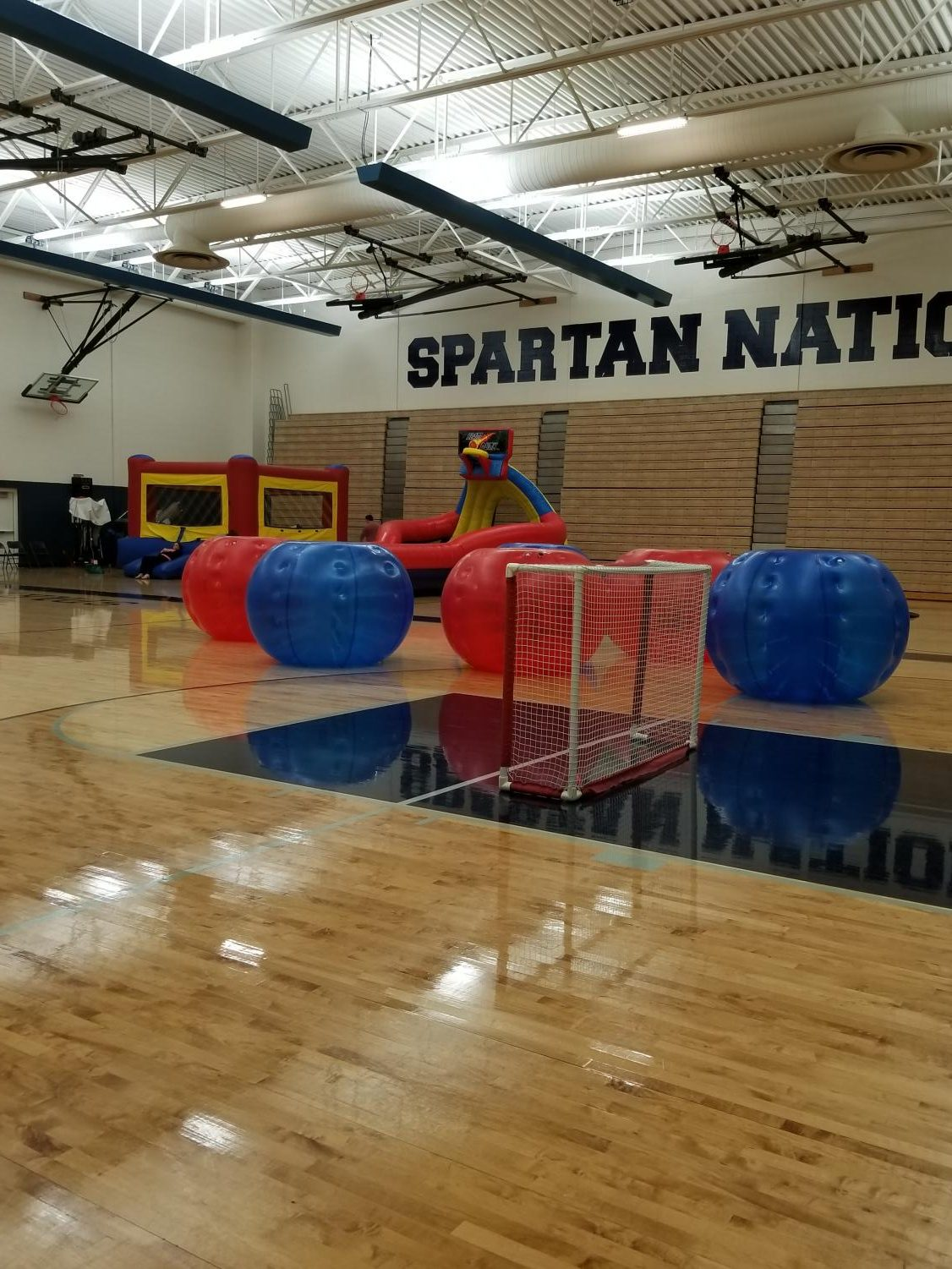 This picture shows some of the activities available at RAP. Pictured is the human soccer ball inflatables and a slide.