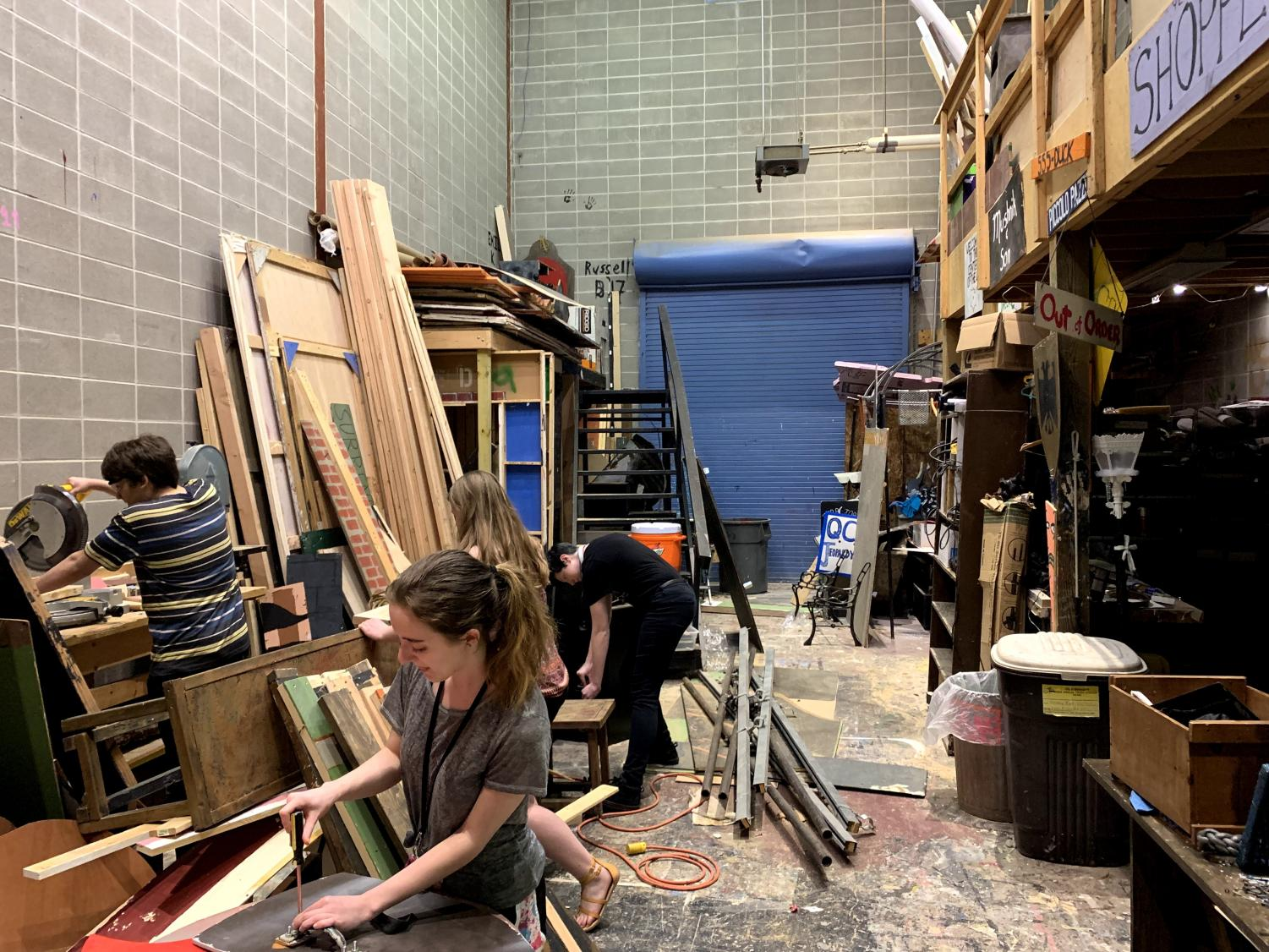 A group of students work in the shop to create the set for She Kills Monsters.