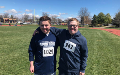 Pleasant Valley students, Ben Babcock and Bob Bender pose for a picture after competing head-to-head in the 50m dash.
