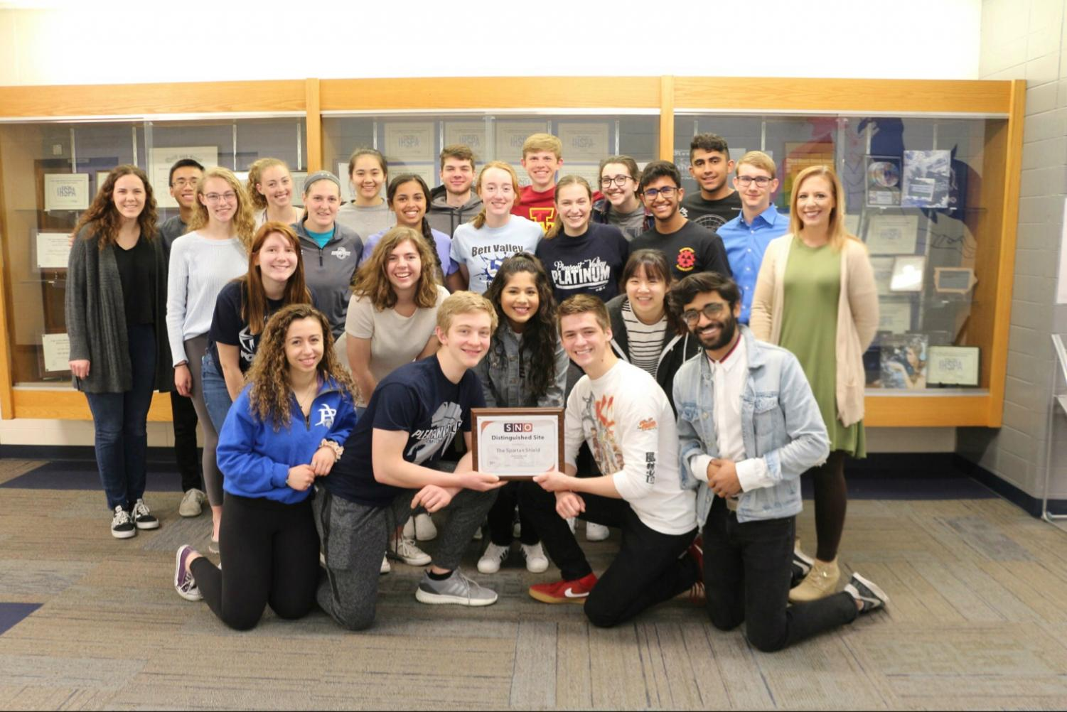 The second semester honors journalism class accepting the Best of SNO award of distinguished site.