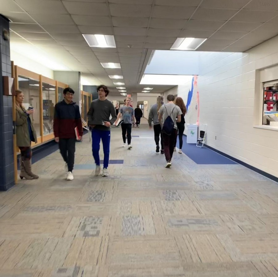 Students+walk+down+the+main+hallway+of+Pleasant+Valley+High+school%2C+next+to+the+library+and+a+school+materials+room.+These+are+both+excellent+studying+spaces+and+materials+for+PV+students.