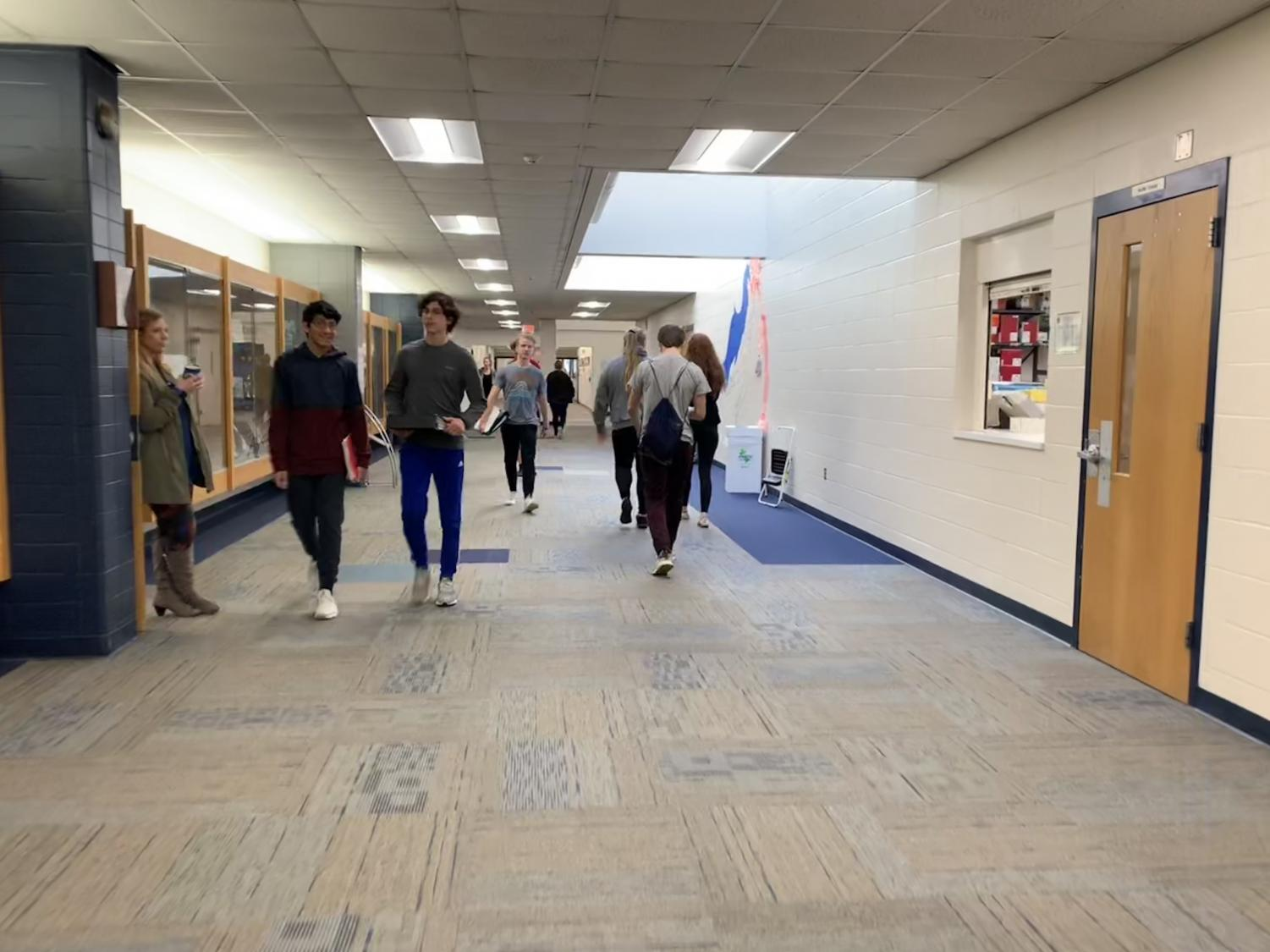 Students walk down the main hallway of Pleasant Valley High school, next to the library and a school materials room. These are both excellent studying spaces and materials for PV students.
