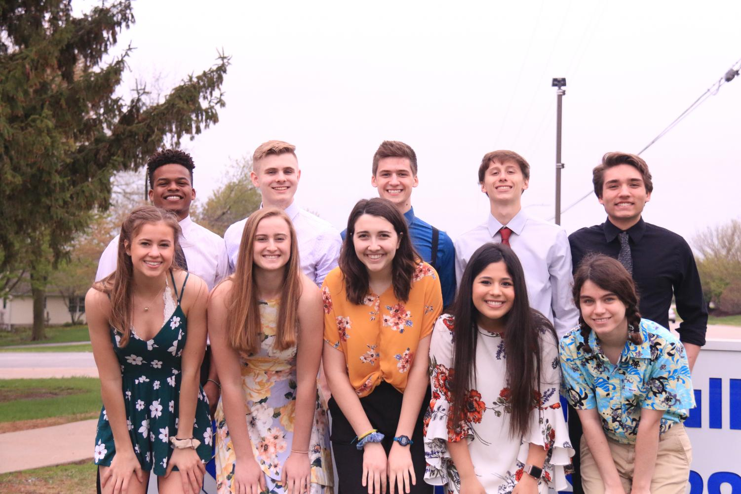 The 2019 Prom Court poses for a photo in front of the Pleasant Valley High School sign.