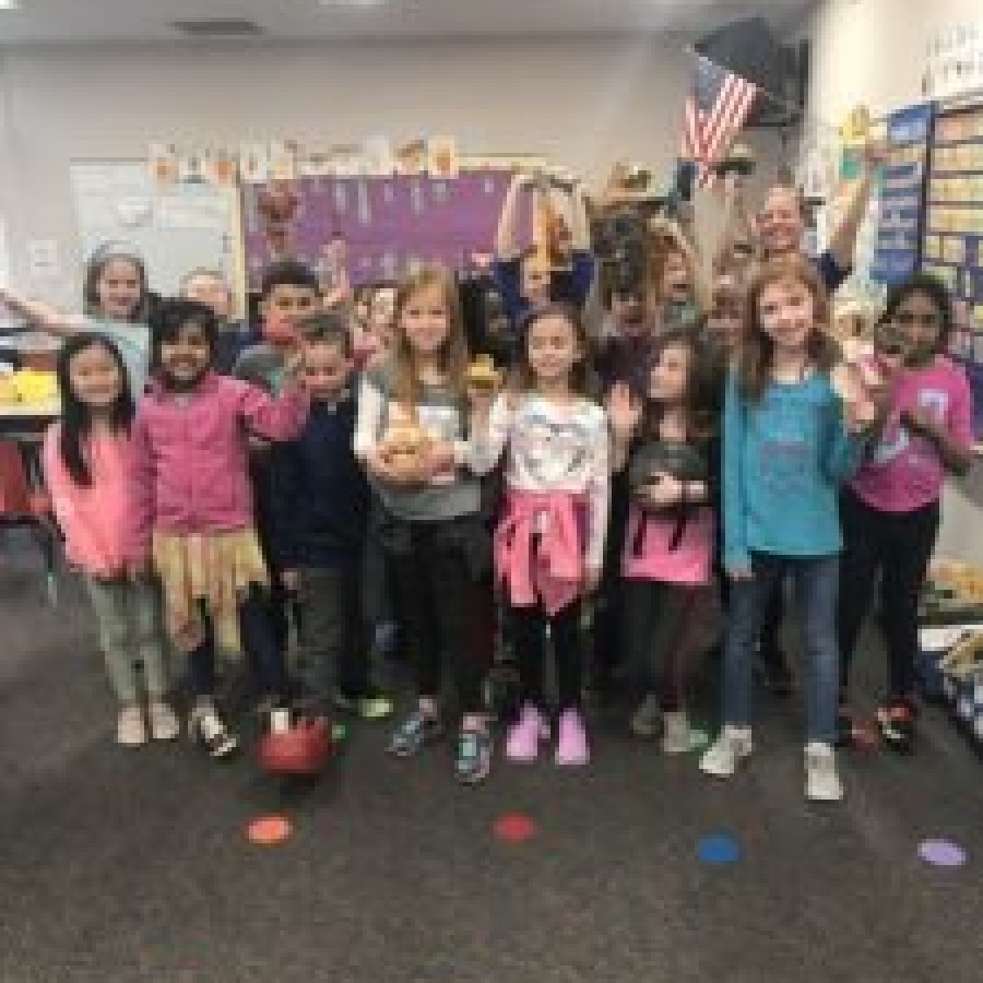 Kelsey Allbaugh's students stand together celebrating their success.