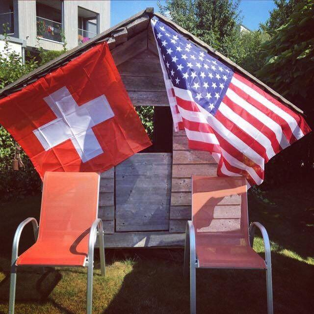 Tessa Brinkhof displays the flag of her home country, Switzerland, and the country she will study abroad in, America, at her farewell party.