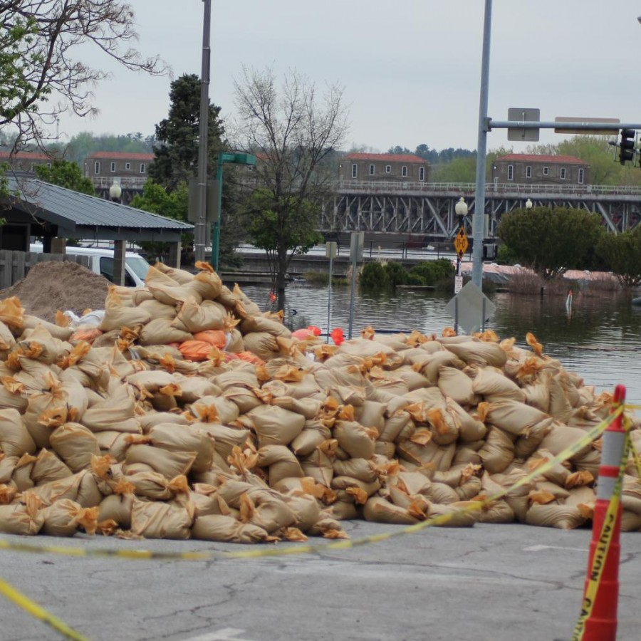 A+pile+of+sandbags+sits+ready+to+combat+the+flooded+streets+of+Davenport.
