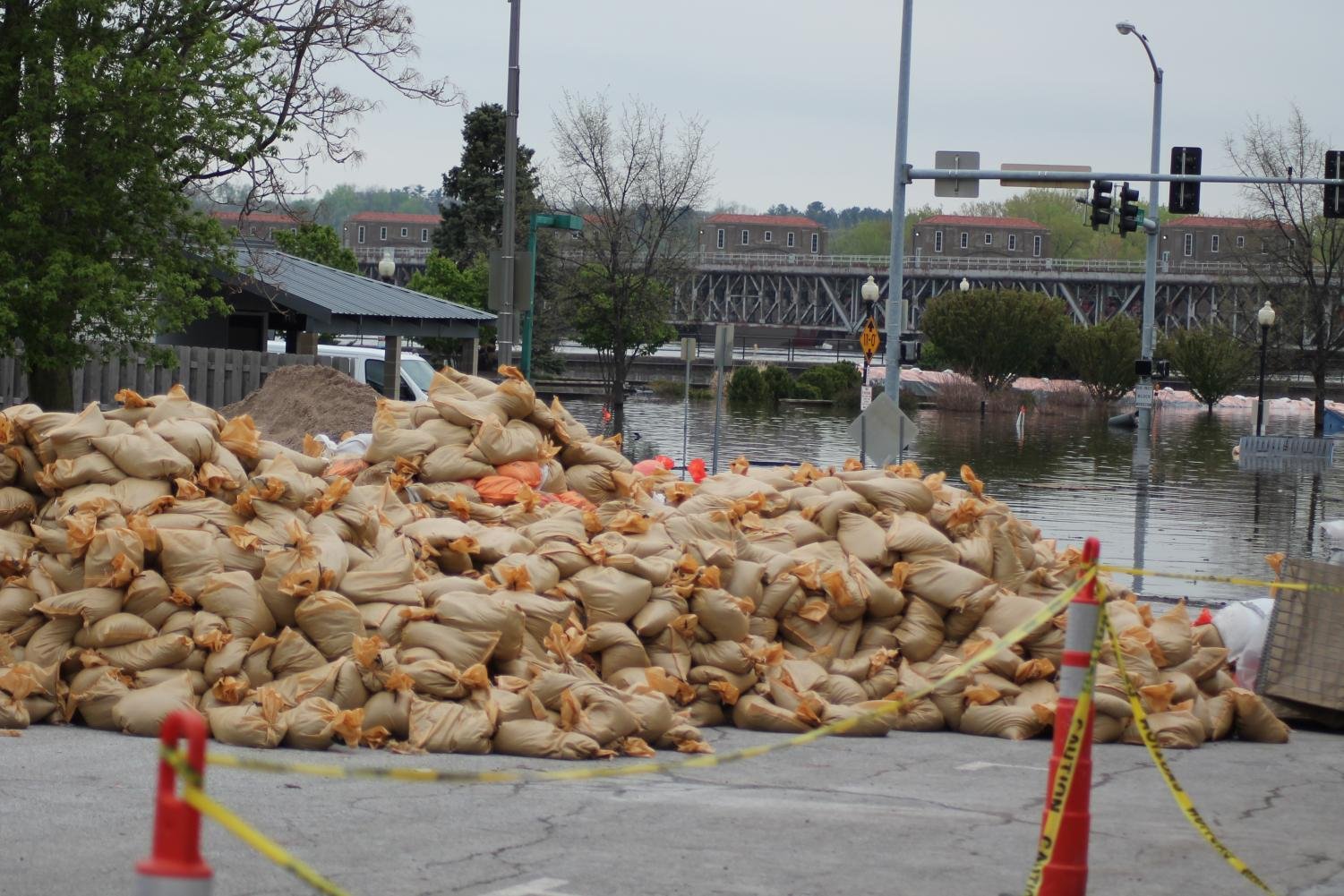 A pile of sandbags sits ready to combat the flooded streets of Davenport.