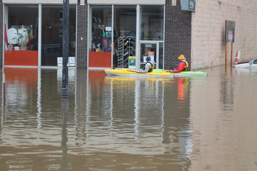 Store owners tried to protect their assets and valuables by accessing the business using canoes and rescue boats