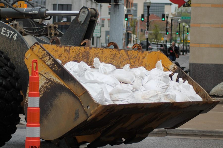 Sandbags packed by volunteers were moved by front loaders to the flood zone.