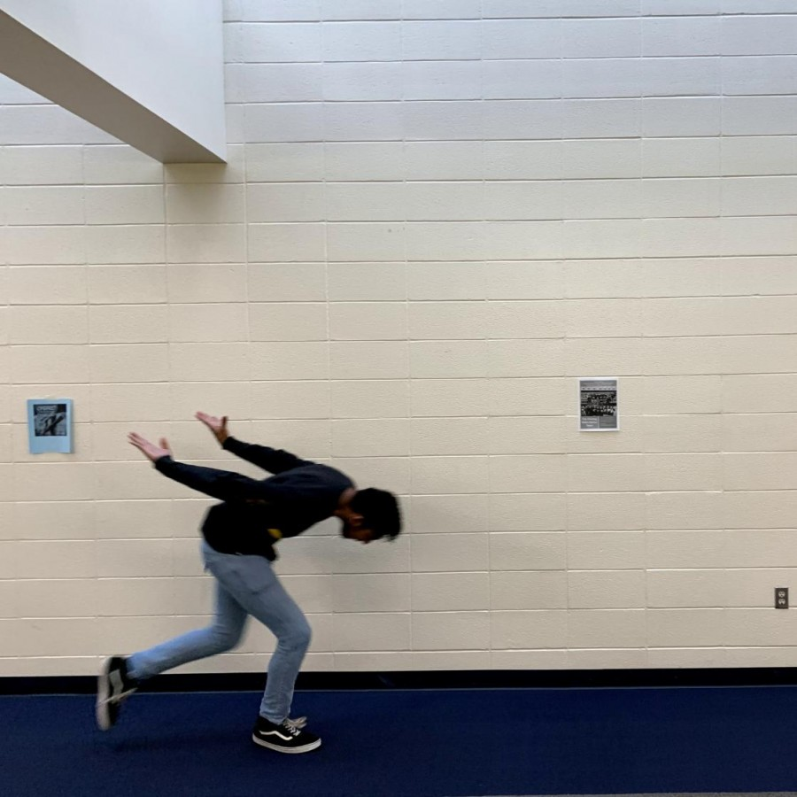 Senior, Joel Kachappilly, runs to get to class in the tower on time.