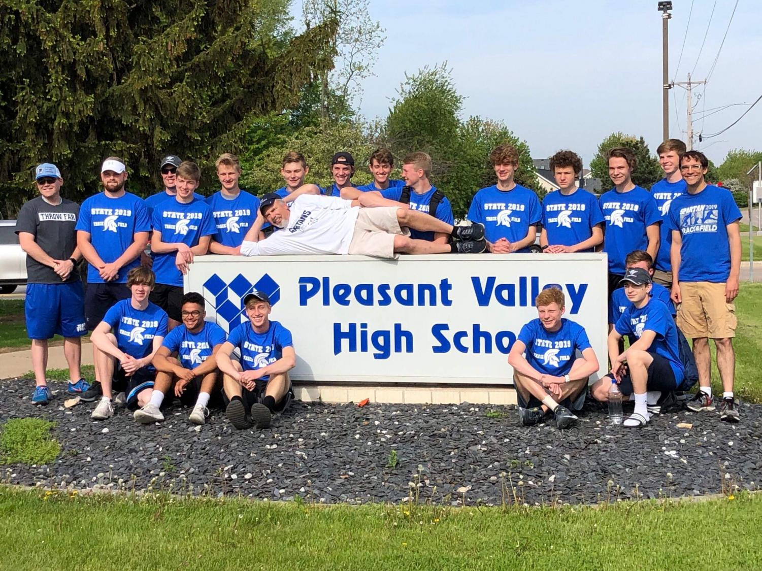 The boys' track and field team gathered around the PVHS sign prior to leaving for the state meet.