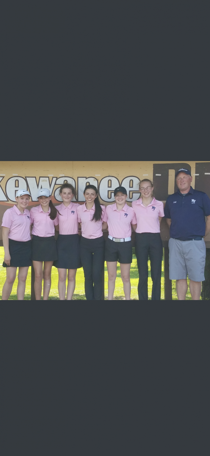 The girl's golf team stands by Coach Kingrey at the MAC meet