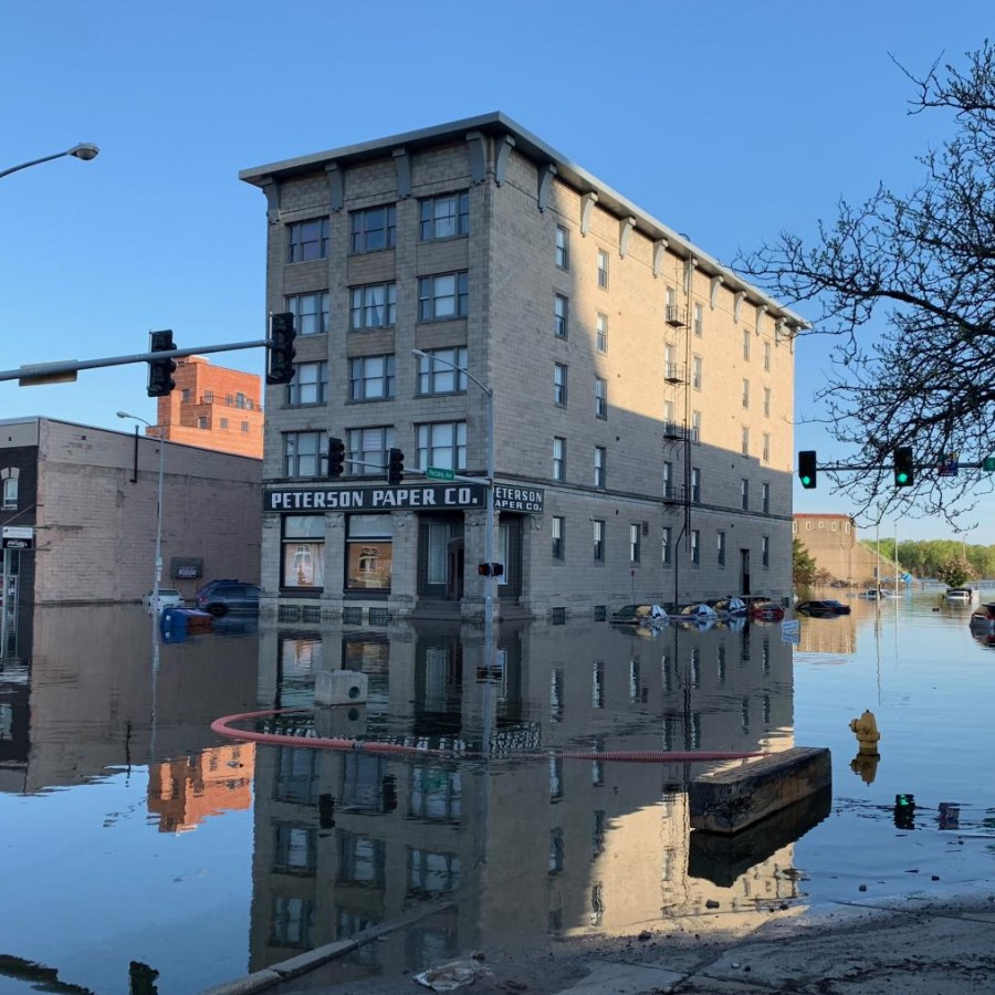 Cars lined up along the streets are barely to be seen, as they drowned in water, in downtown Davenports on the street of E 2nd St.