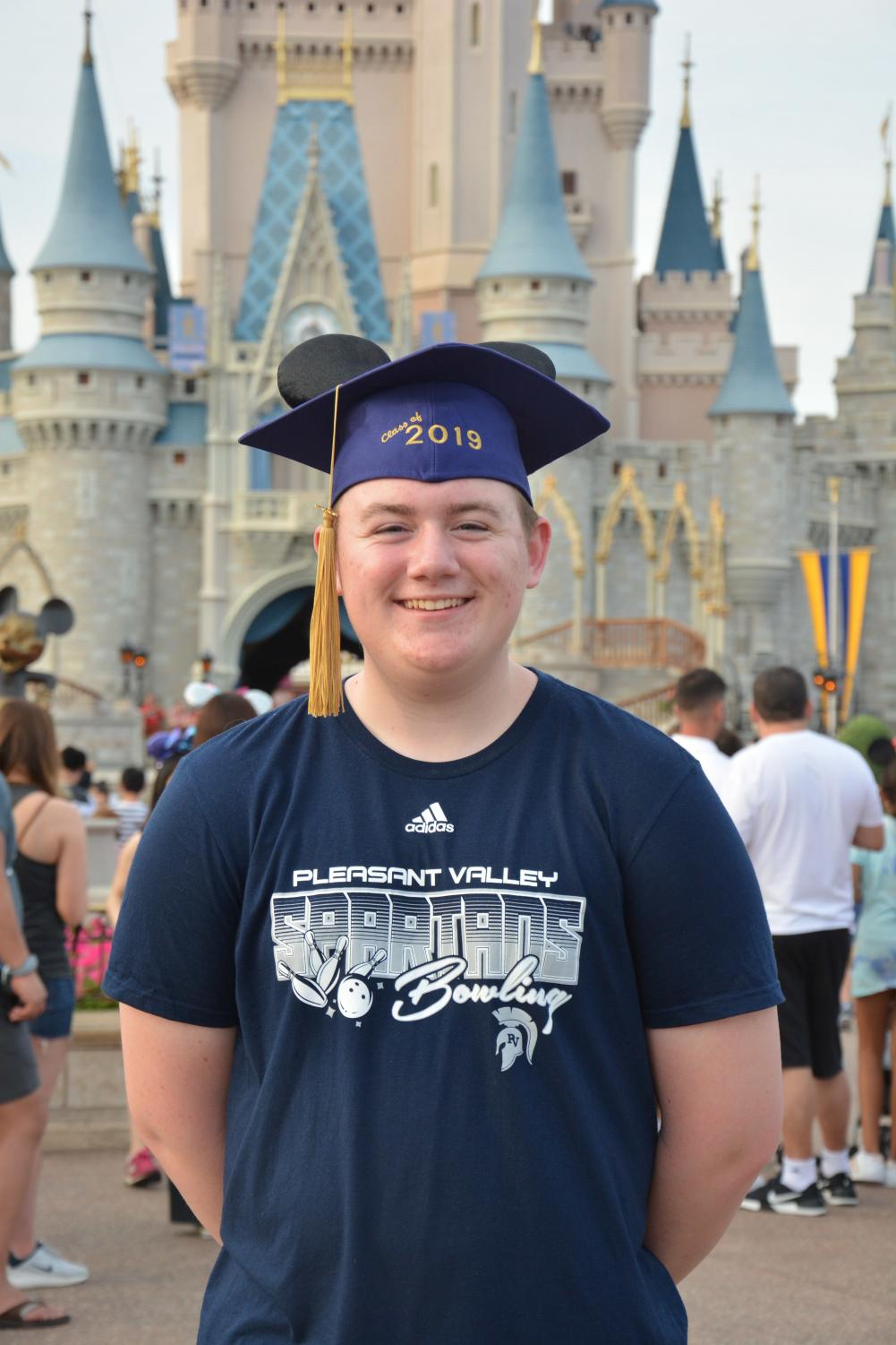 Alton Barber poses in front of the famous Cinderella Castle at Disney World