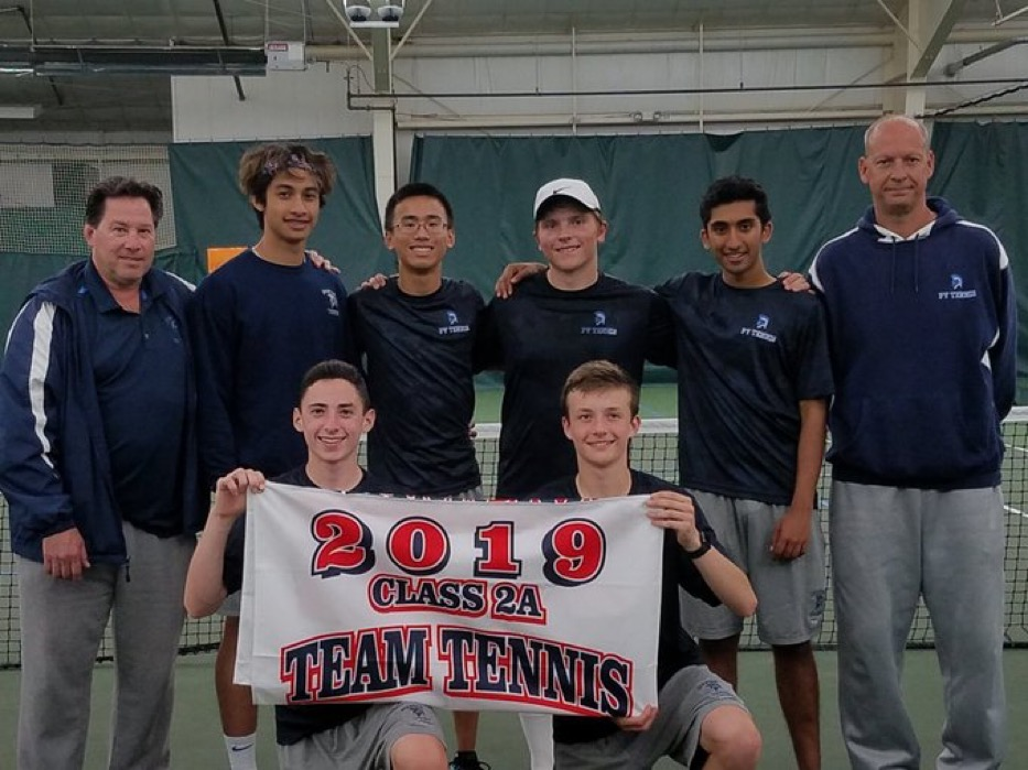 The Pleasant Valley boys' tennis team holds their banner after claiming the district title.