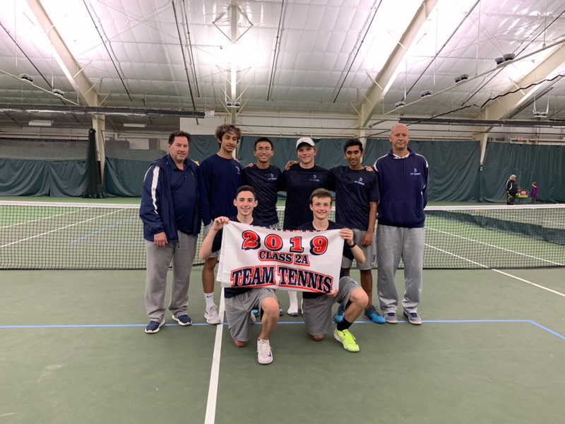 The+boys%27+tennis+team+is+all+smiles+after+becoming+a+state+qualifier.