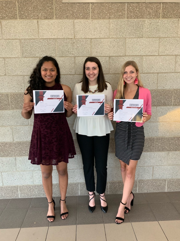 Pleasant Valley seniors, (from left to right) Susan Anil, Natalie Murphy, and Lily Williams hold up the certificates presented to them at the Quad City Times Salute to Academics and Achievements.
