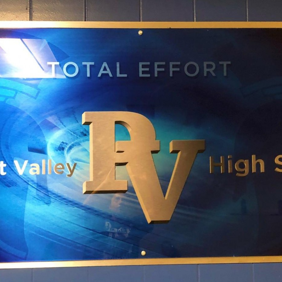 A display on the wall shows how PV is committed to excellence on all fronts.