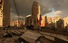 US civilians stand among the destruction of the World Trade Center after the buildings are hit on September 11th, 2001.