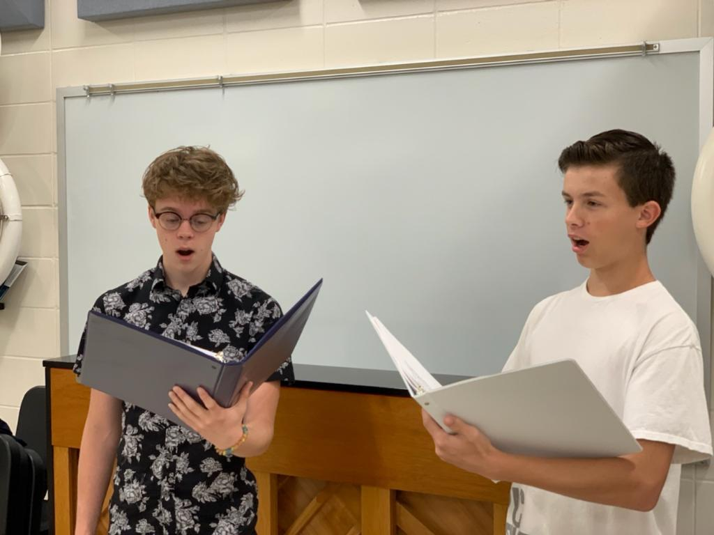 John Mendelin (left) and Rece Vining (right) practice for their All State choir audition.
