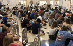 Pleasant Valley band students prepare for an upcoming marching band performance during their fifth period class.