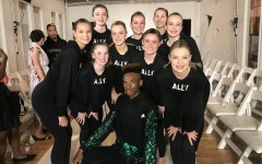"Hannah Lederman and her fellow Nolte Academy dancers sport their Humanize My Hoodie ""ally"" sweatshirts and pose with a runway model on Sept. 14 at New York Fashion Week."