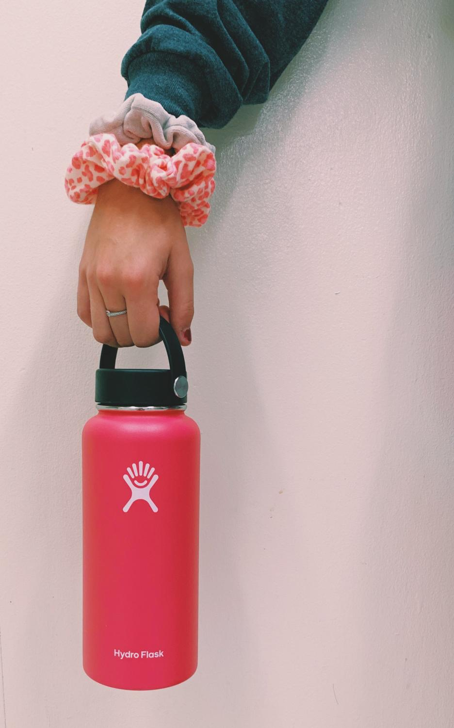Ava Sorgenfrey gathers her hydro flask and scrunchies, two essentials which help to characterize the stereotypical