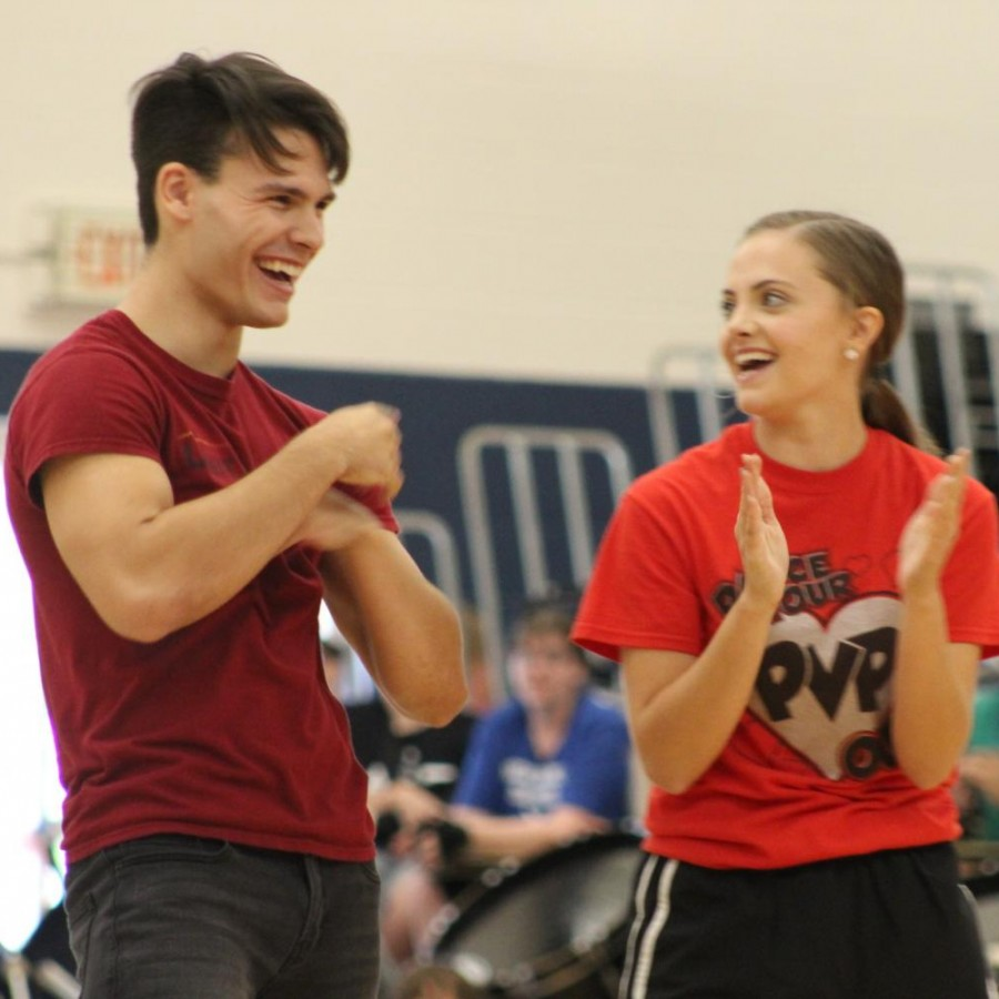 Bradley+Hamilton+and+Morgan+McCartney+celebrate+together+after+finishing+their+choreographed+dance+for+the+student+body+during+the+Student+Hunger+Drive+Assembly+on+Friday%2C+Sept.+20+at+PVHS.