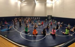 Girls cross country runners practice mindful breathing, guided by Julie Murphy.