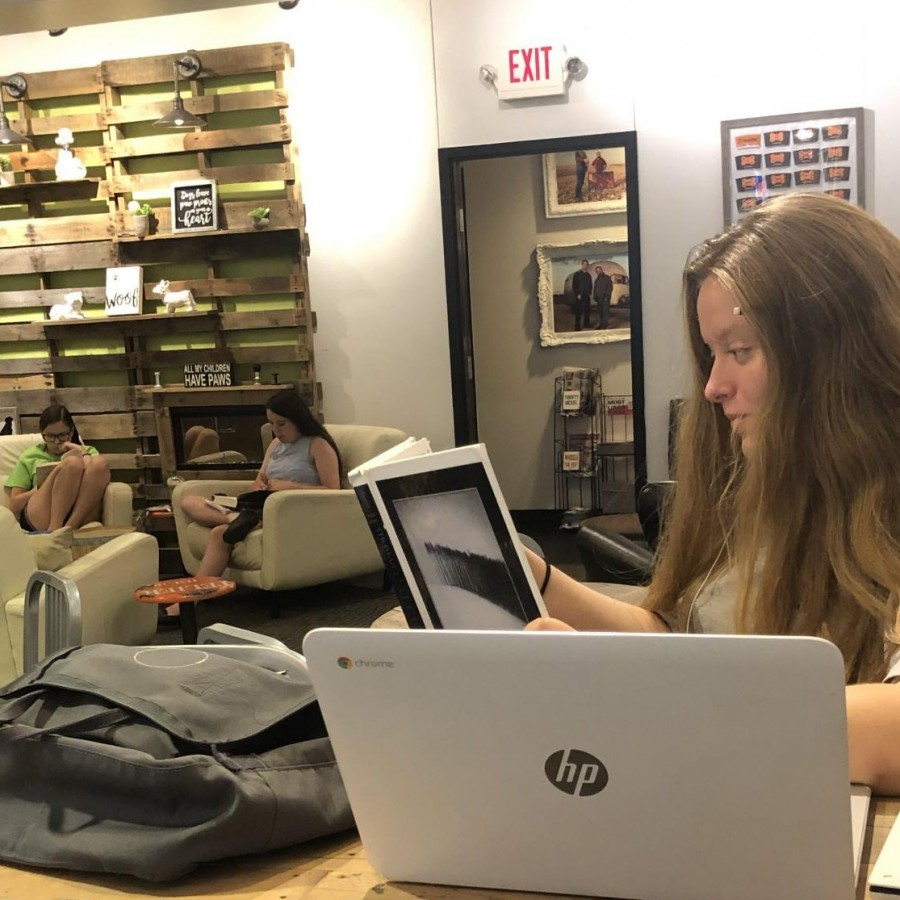 Maddie+Murphy+studies+at+local+coffee+shop%2C+Coffee+Hound%2C+after+a+busy+day+at+school.%0A