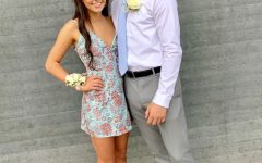 Julia Necker (20) pictured with Logan Colliar (20), wearing her light blue and floral homecoming dress.