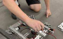 Kyle Sehlin is seen working on Everything Thats Radical's robot.