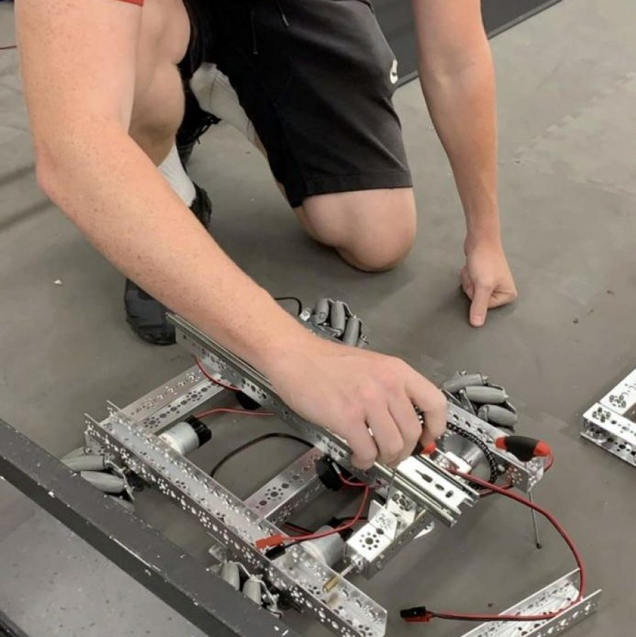 Kyle Sehlin is seen working on Everything That's Radical's robot.