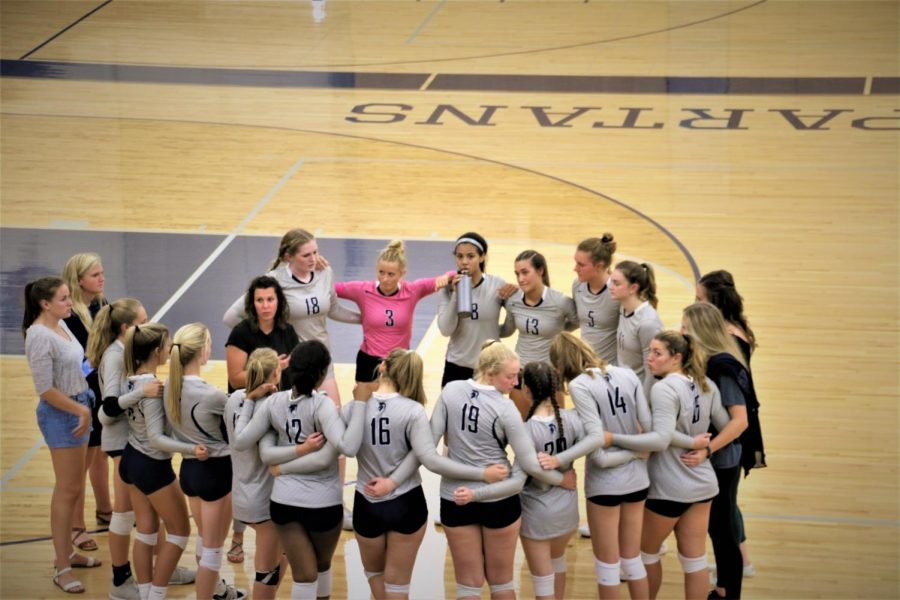 The team getting a pep talk from coach, Amber Hall, at the first home game of the season vs. Central.