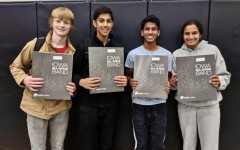 (From left to right) Sam Mcgrath, Ani Pradeep, Sanjiv Iyer, and Amulya Pillutla pictured with their All-State packets after being accepted into the All-State Band.