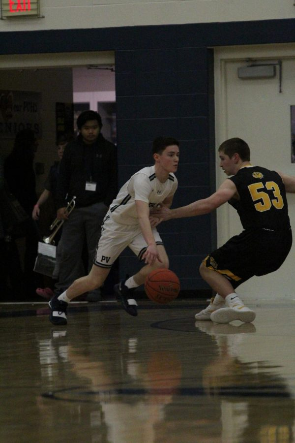 Sophomore Ryan Dolphin dribbles past Bettendorf Senior Joe Byrne in last year's rivalry game at PV.